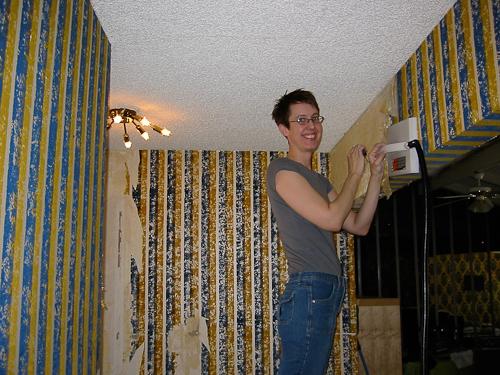 Heidi Taking Down Wallpaper