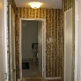 hallway with flocked wallpaper