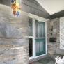 mid-century-stone-porch-with-decorative-cement-block