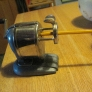 Manual pencil sharpener with a feeder. $3