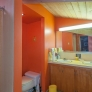 midcentury-orange-bathroom-retro
