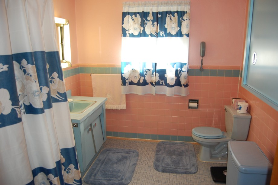 Nora s time capsule house retro renovation for Pink and blue bathroom accessories