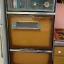 mid-century-50s-pink-and-pine-kitchen-built-in-faux-wood-caloric-oven-and-stove