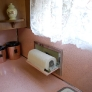 mid-century-50s-pink-and-pine-kitchen-built-in-paper-towel-holder-exposed