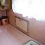 mid-century-50s-pink-and-pine-kitchen-built-in-paper-towel-holder