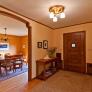 entry-way-with-original-vintage-woodwork-and-door