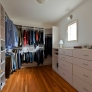 walk-in-closet-with-built-in-shelving