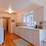 white-laminate-kitchen-wood-floor