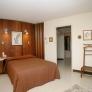 mid-century-bedroom-wood-wall