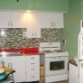 youngstown-kitchen-red-counters-green-walls-red-and-green-tile-backsplash