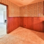 mid-century-kitchen-with-paneling-and-wallpaper