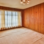 mid-century-wood-paneled-den