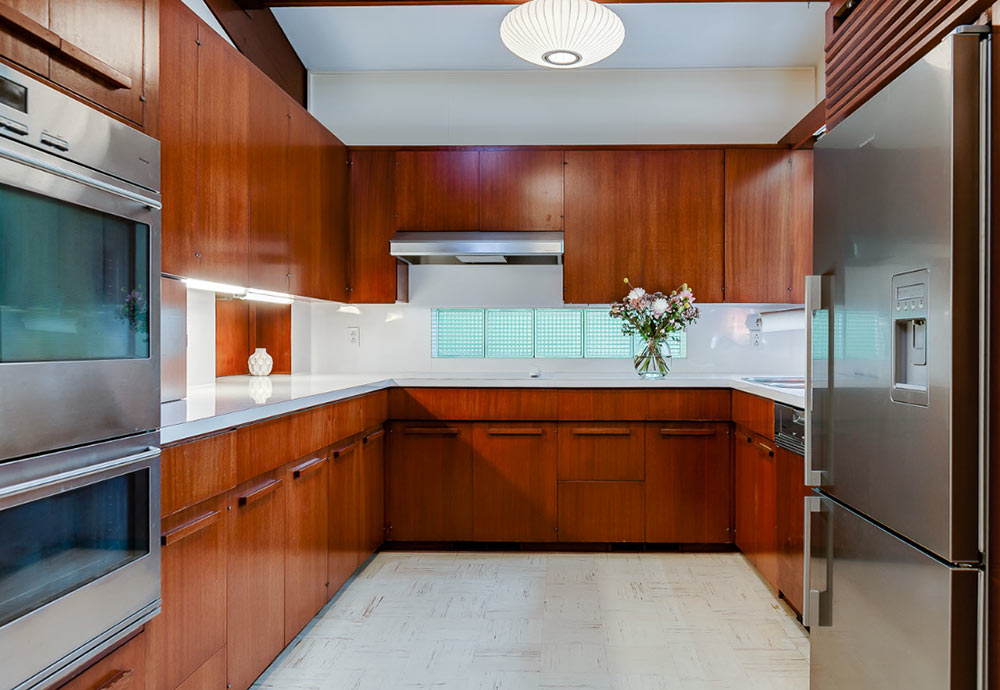 Stunning mid century modern toronto time capsule house by - Mid century kitchen cabinets ...