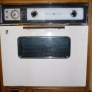 Our 1964 GE wall oven.  Repainted an almond color by orignal owner after pink no longer stylish.