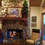 fireplace-with-fire-and-ethan-allen-chair-cf79ae323f1be1f2e01bf8fee6eff3cf0f131c01