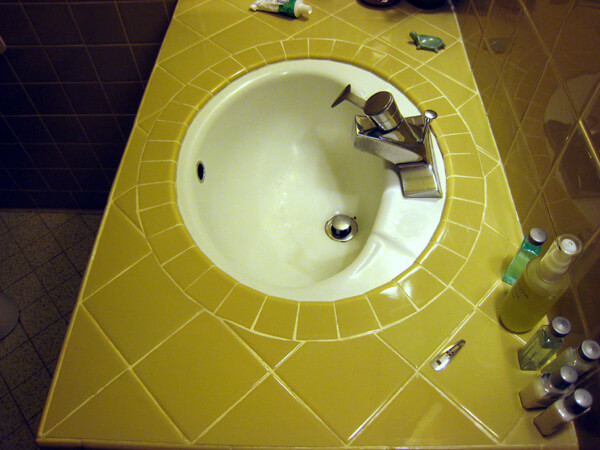 vintage bathroom sink surrounded by tile counter top