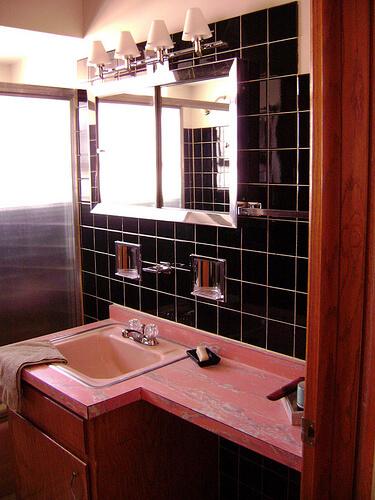 black wall tile bathroom