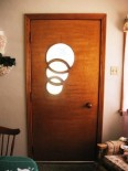 mid century front door with three inter locked circles