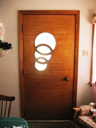 mid century front door with three inter locked circles