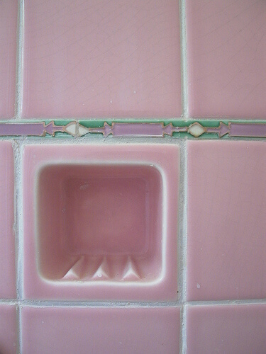 Pink bathroom tile with green and lilac liner