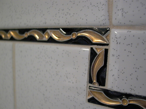 Retro salt and pepper tile with black and gold liner