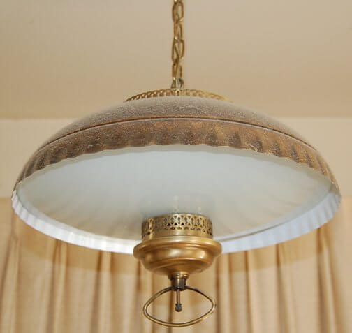 A Pull Down Coppertone Dining Room Light