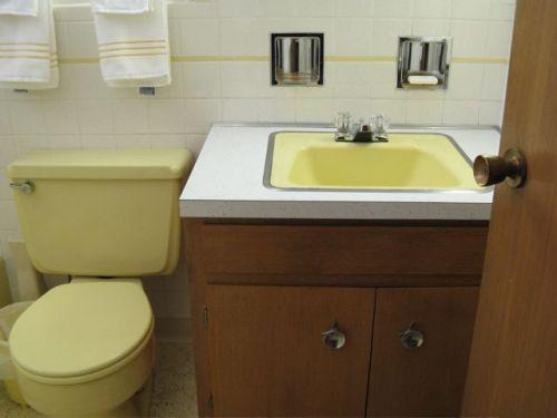 yellow bathroom sink and toilet