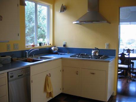 retro renovation kitchen yellow cabinets