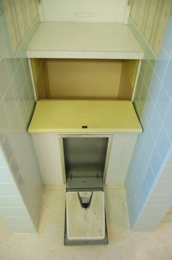 vintage-bathroom-laundry-chute-and-recessed-scale