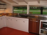 Garth and Martha have pro's soda blast and electrostatically paint their vintage Crosley steel kitchen cabinets