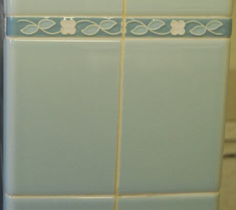 1960s-blue-tile-with-decorative-flower-liner