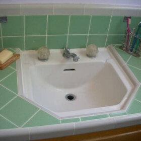 bathroom sink tiled into counter top