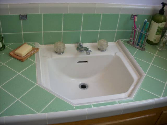 bathroom sink tiled into counter top