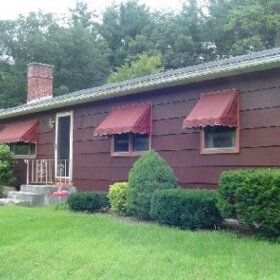 house with fabric awnings