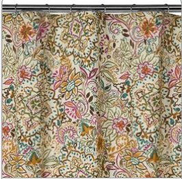 This Shakira shower curtain is new at Target - you can see how putting this into a pink-tiled bathroom would give you numerous possibilities to use other strong accent colors to draw attention away from the pink tile. And it's not