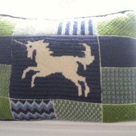 unicorn pillow in needlepoint