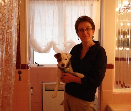sheila-and-her-puppy-in-her-pink-bathroom