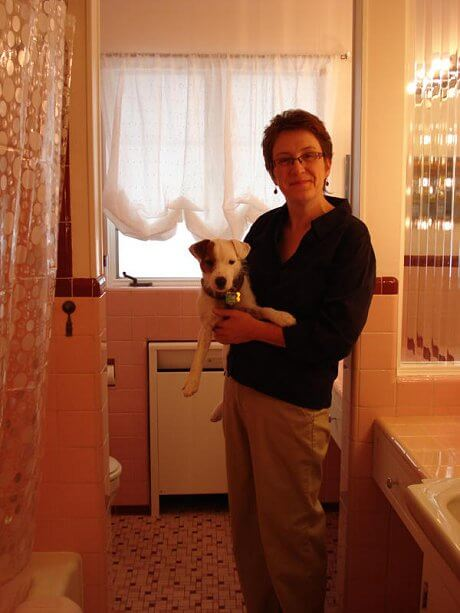 sheila-and-puppy-in-her-pink-bathroom