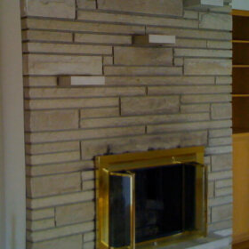 fireplace with built in stone shelves