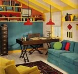a 1970 attic design with blue sofa and orange pendant lighting