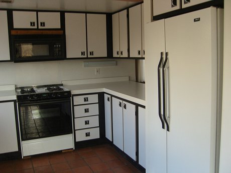1976 kitchen with black and white laminate cabinets