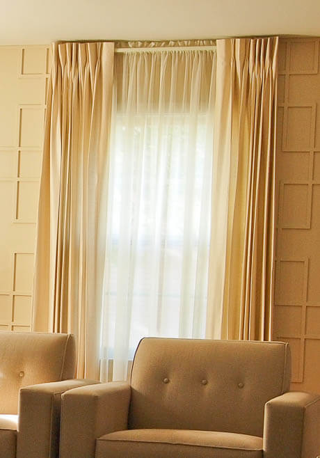 pinch pleat curtains over sheer panels