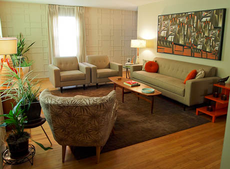 mid century modern living room with orange accessories