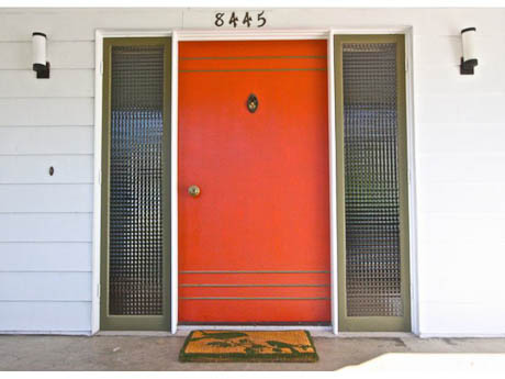 red orange front door on a mid century home