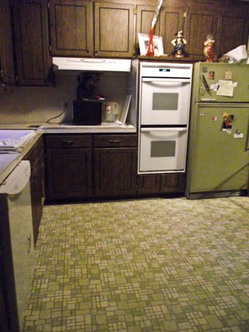 1960s kitchen with avocado floor and refrigerator