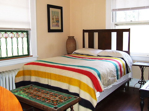 bungalow bedroom with pendelton blanket