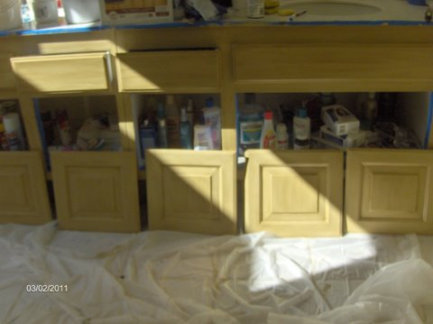 doors off connies kitchen cabinets in the process of repainting using rustoleum cabinet transformations