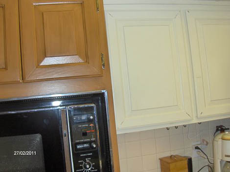 connies kitchen in the process of repainting with rustoleum cabinet transformations
