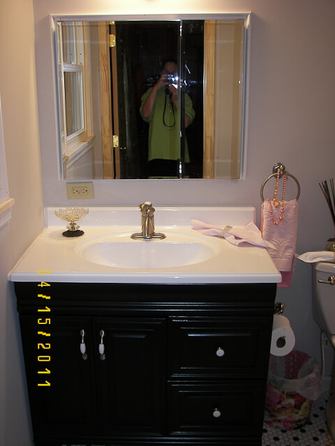 bathroom vanity painted black using rustoleum cabinet transformations kit
