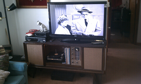 vintage stereo retrofitted to hold plasma tv